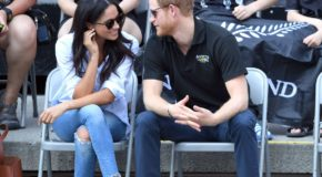 Prince Harry and Meghan Markle hold hands and whisper sweet nothings in public for the first time